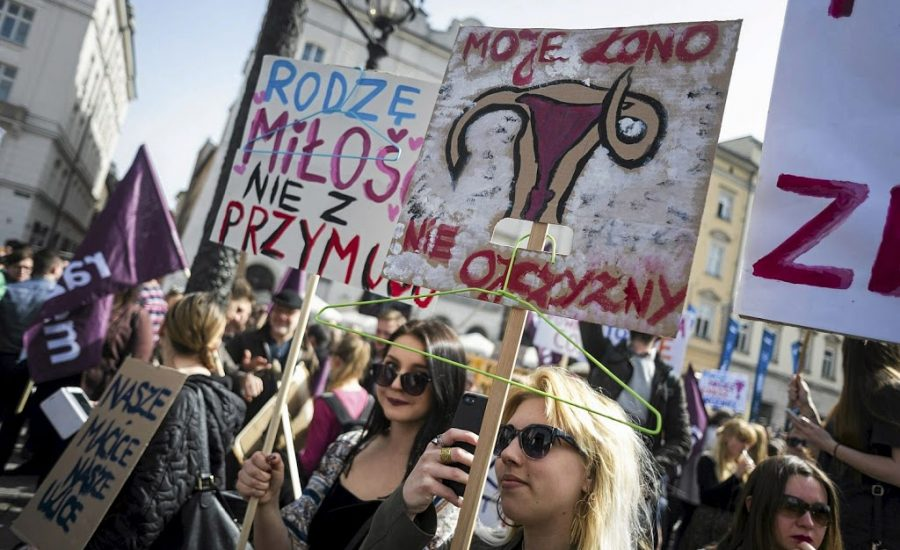"""People demonstrate against the Polish government's plan to tightening the abortion law in Krakow, Poland April 3, 2016. The signs read: """"I'm giving birth from love not from being forced"""" and """"My womb does not belong to homeland"""" (R). REUTERS/Lukasz Kaminski/Agencja Gazeta  ATTENTION EDITORS - THIS IMAGE HAS BEEN SUPPLIED BY A THIRD PARTY. IT IS DISTRIBUTED EXACTLY AS RECEIVED BY REUTERS, AS A SERVICE TO CLIENTS. POLAND OUT. NO COMMERCIAL SALES IN POLAND."""